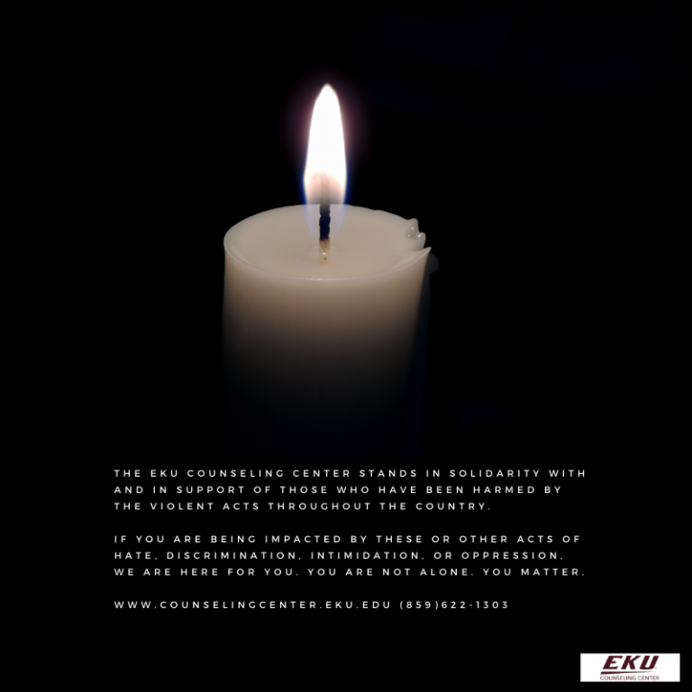image of white candle, lit, on a black background. A message is below